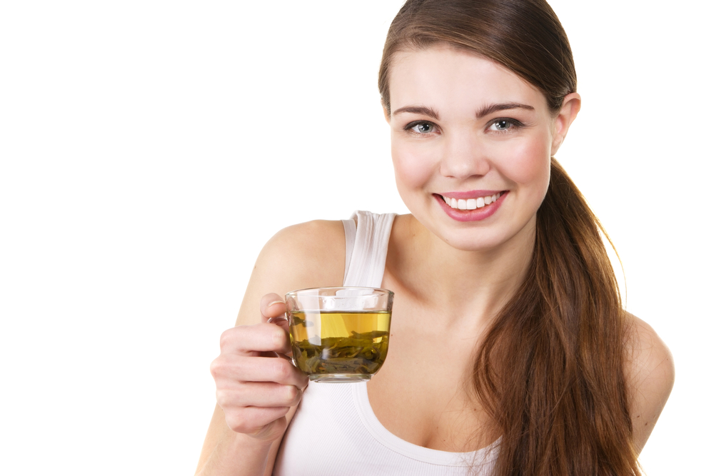 Lady drinking green tea with healthy smile